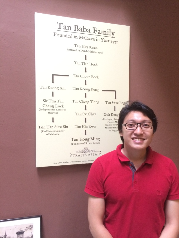 Isaac Tan Kong Ming with his family tree